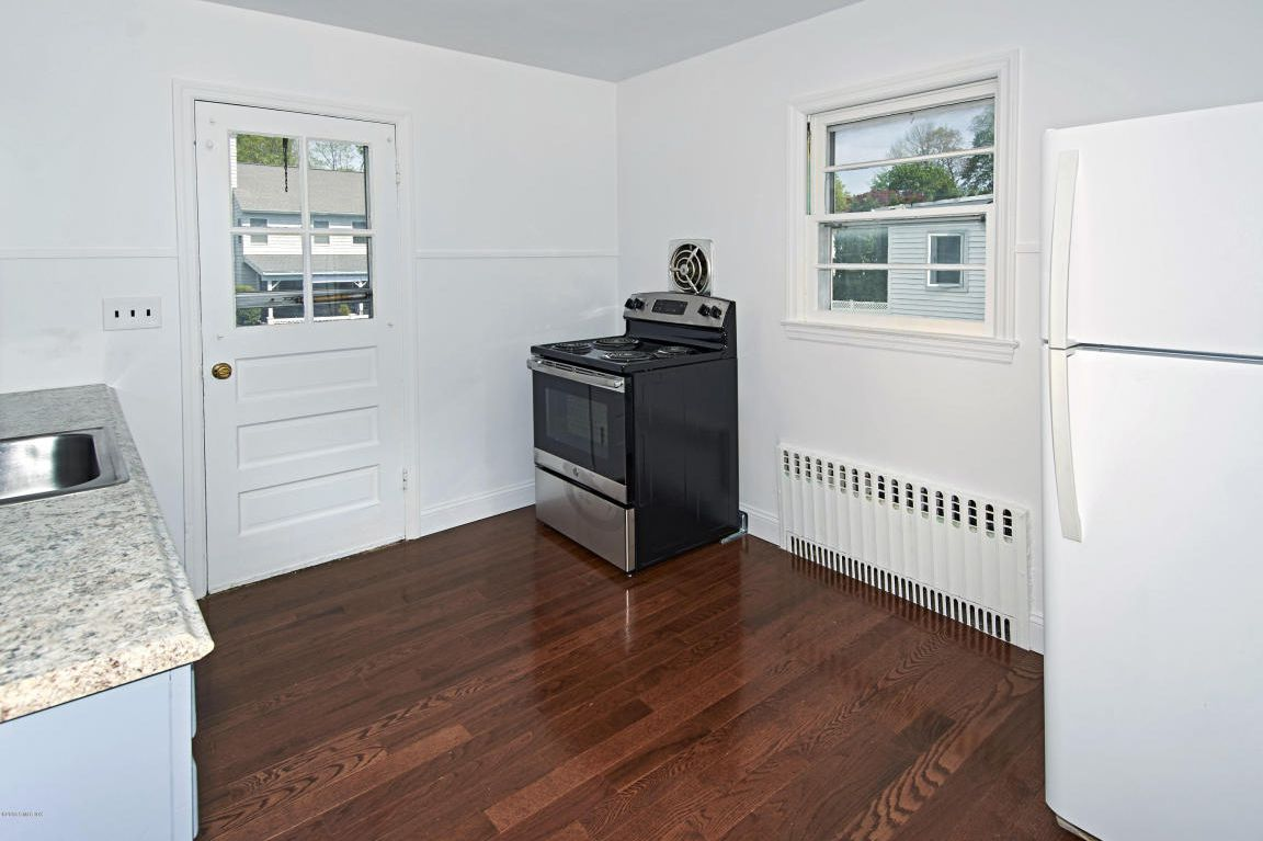 """That same listing claims that this is a """"just renovated"""" kitchen. Maybe the wall vent is new?"""