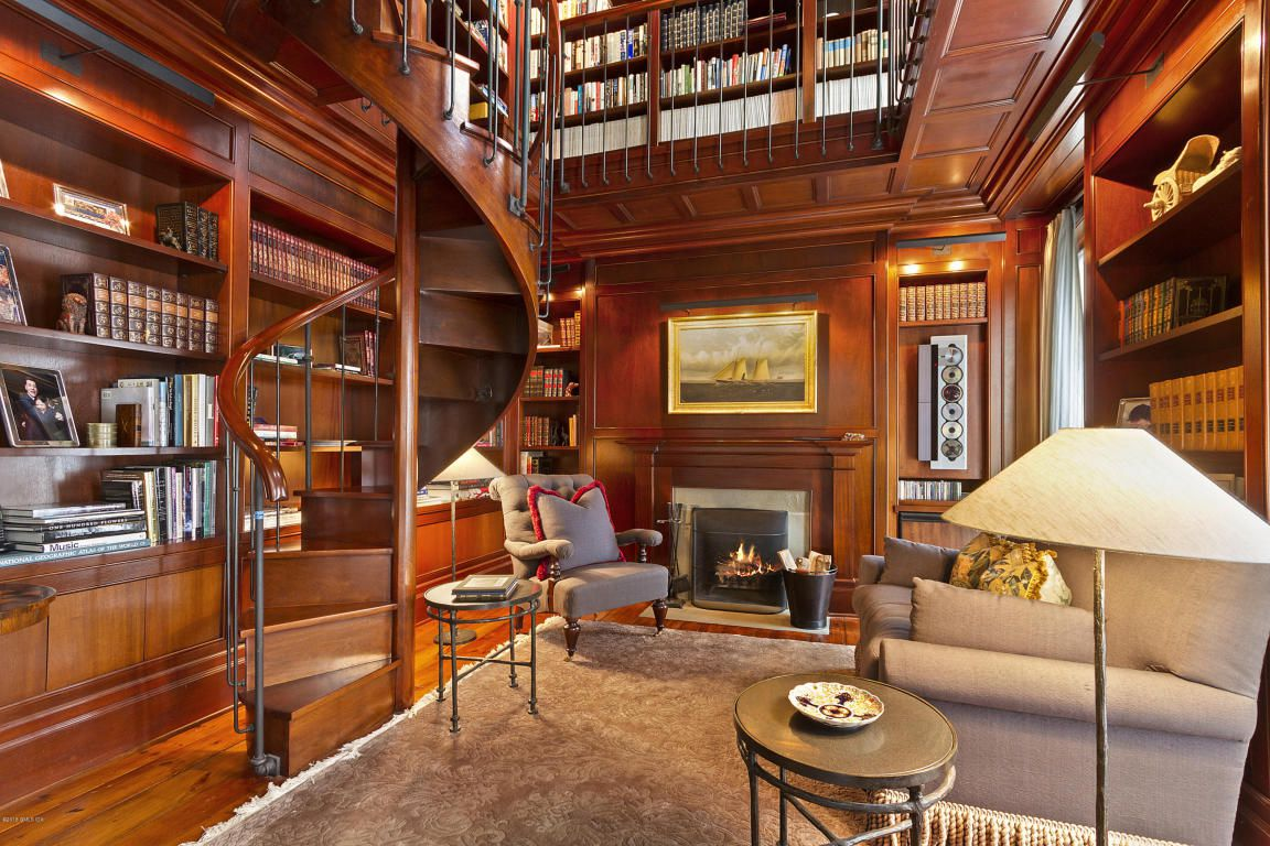 If i had to, i'd tear down the rest of the house and live in this library