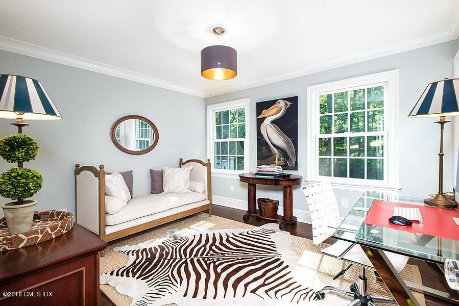 We've seen this pelican before, and Zebra Three — do you Suppose David Ogilvy rushes around toting the same pelt and art work around the house, or hire assistants?