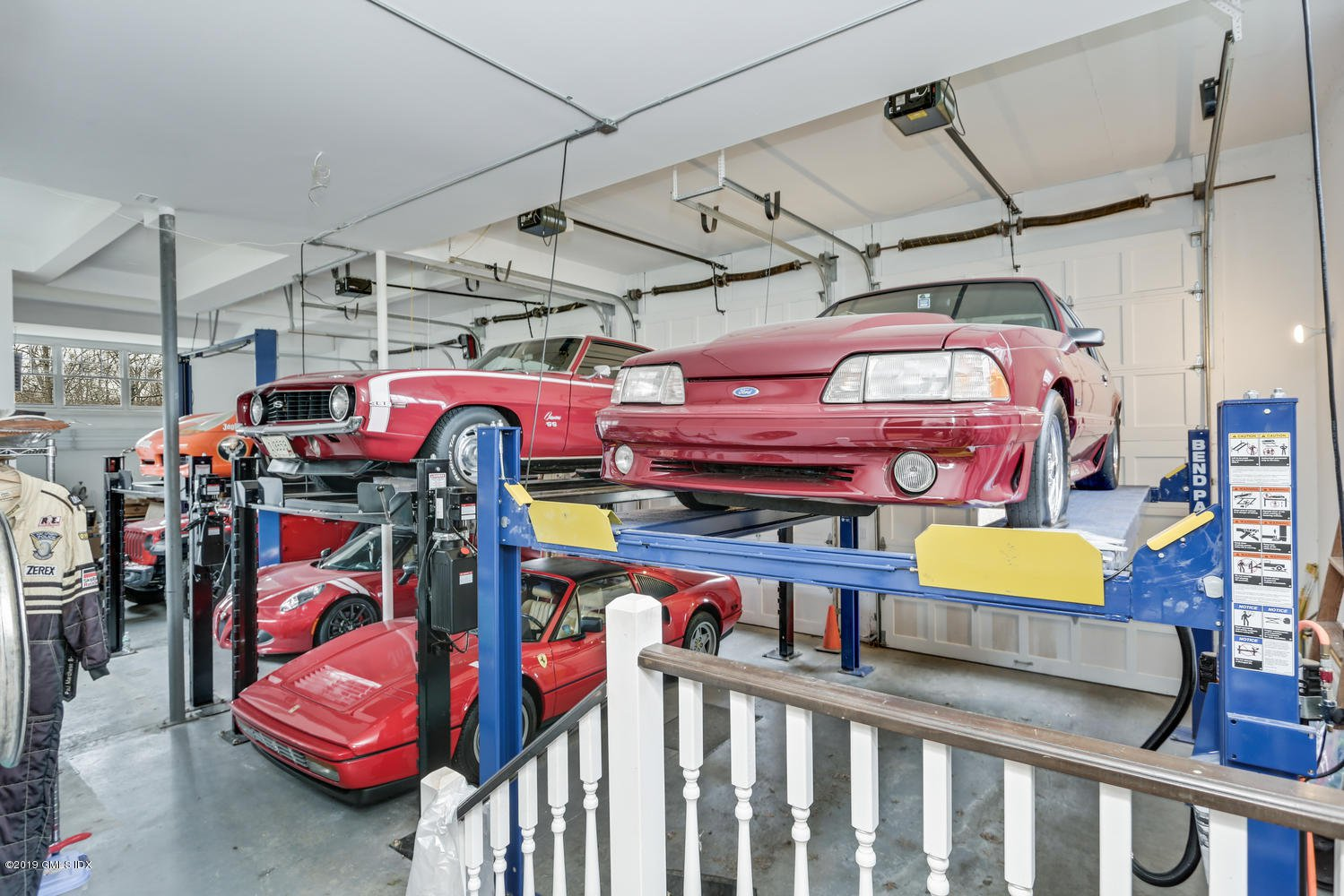 Yes, the owner/architect is a car aficionado — room for at least eight here.