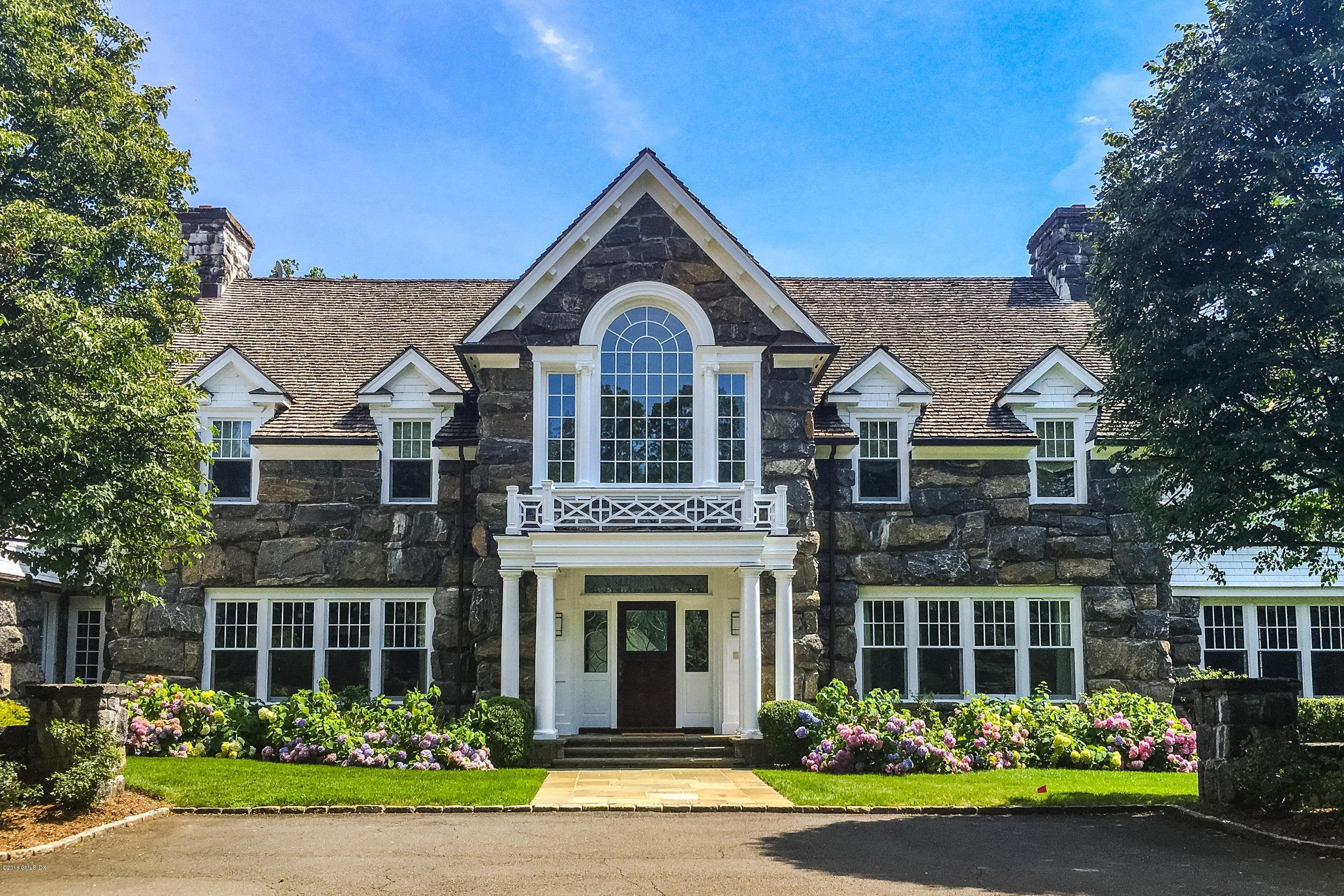 200 Old Mill Road. sold 2006, $6.3 million. Going begging today, asking $4.450. Current assessment: $6,389,100.  Just sayin'.