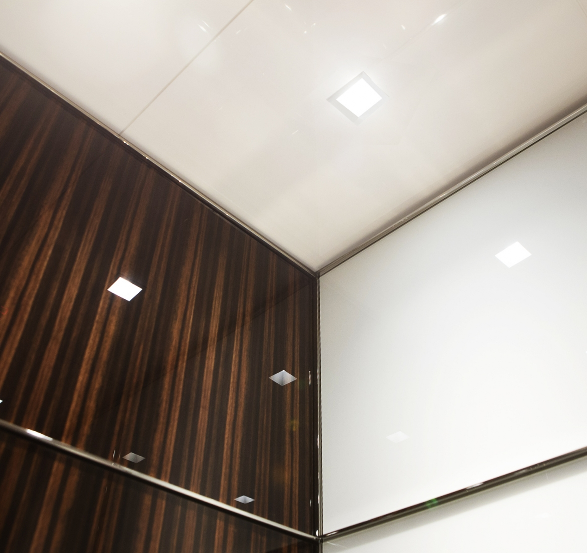 The beautiful ebony wood panels in our 529 5th Avenue cabs are adorned by Elevecture with their 2mm clear  Corning® Gorilla® Glass  panels.   FULL PROJECT GALLERY - 529 5TH AVENUE