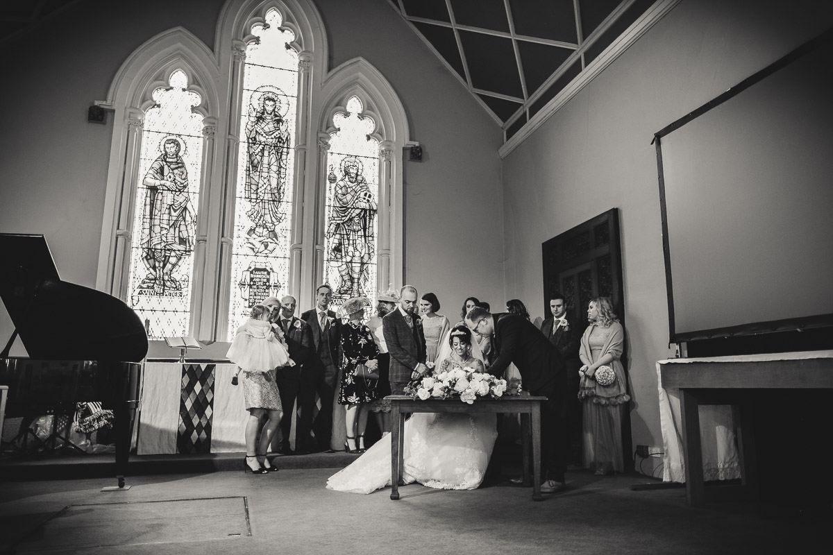 Signing the register at the church