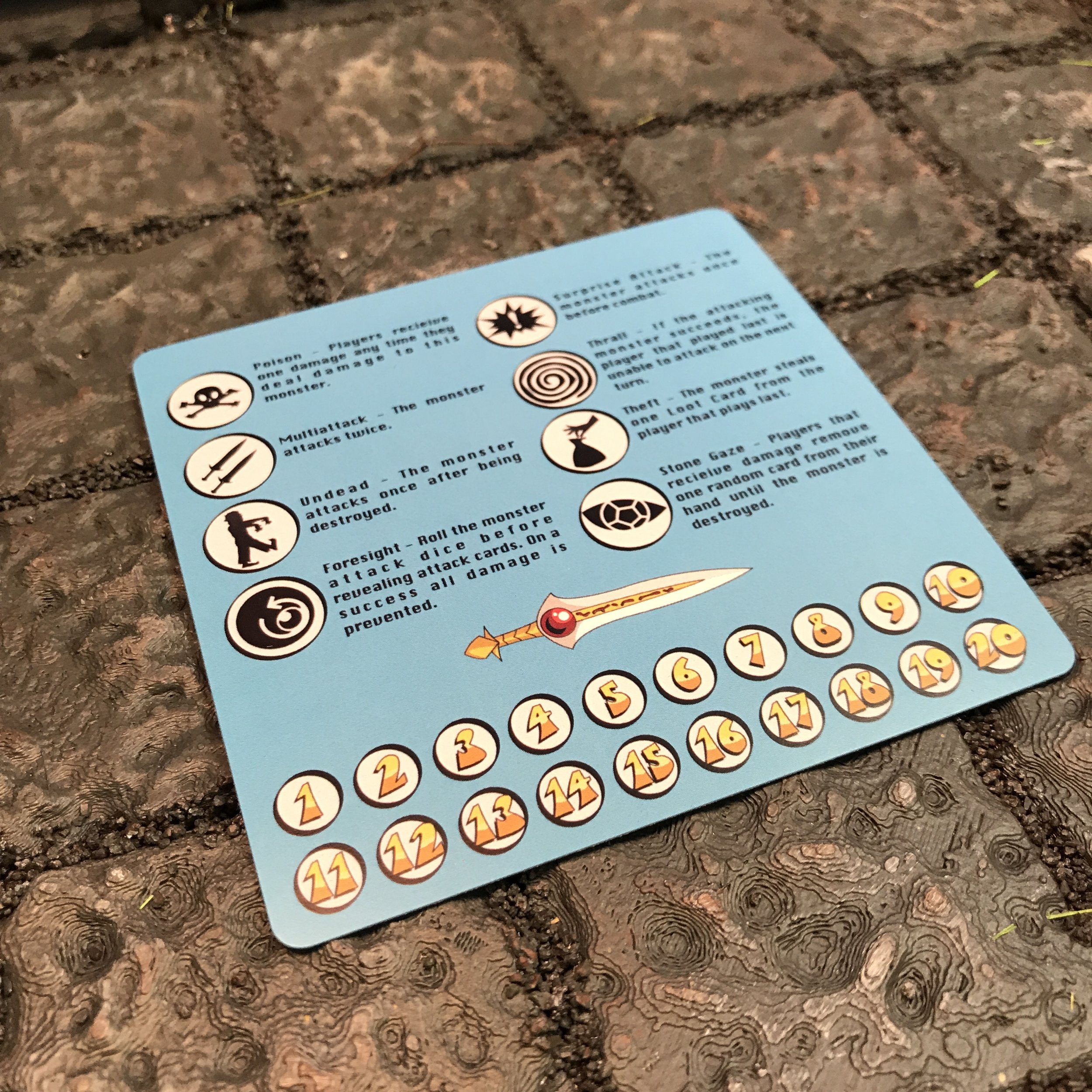 The player aid provides easy access to monster ability symbols and damage tracker.