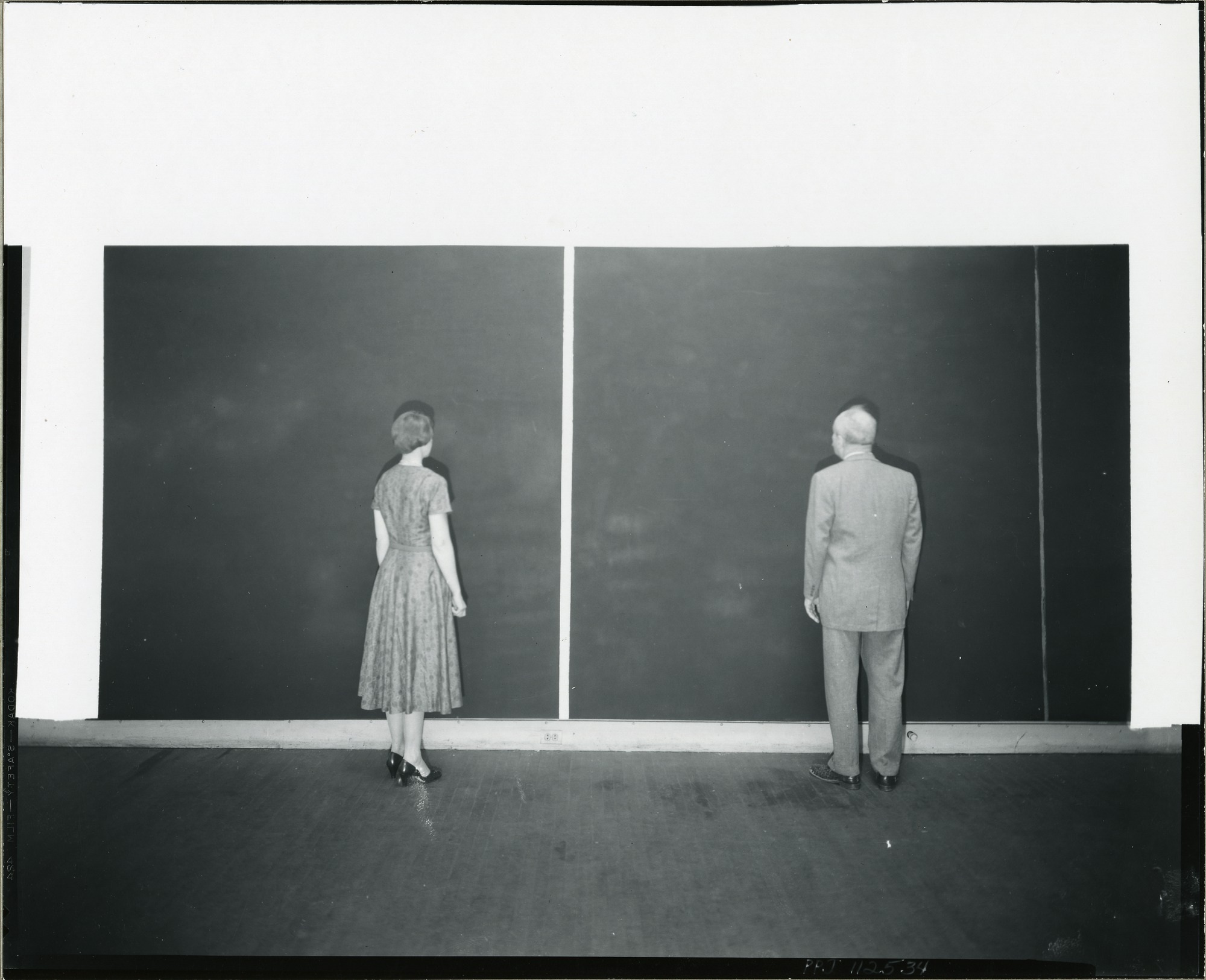 barnett-newman-and-unidentified-woman-standing-in-front-of-22cathedra22-in-his-front-street-studio-new-york-1958-photographed-by-peter-a-juley-peter-a-juley-son-collecti.jpg
