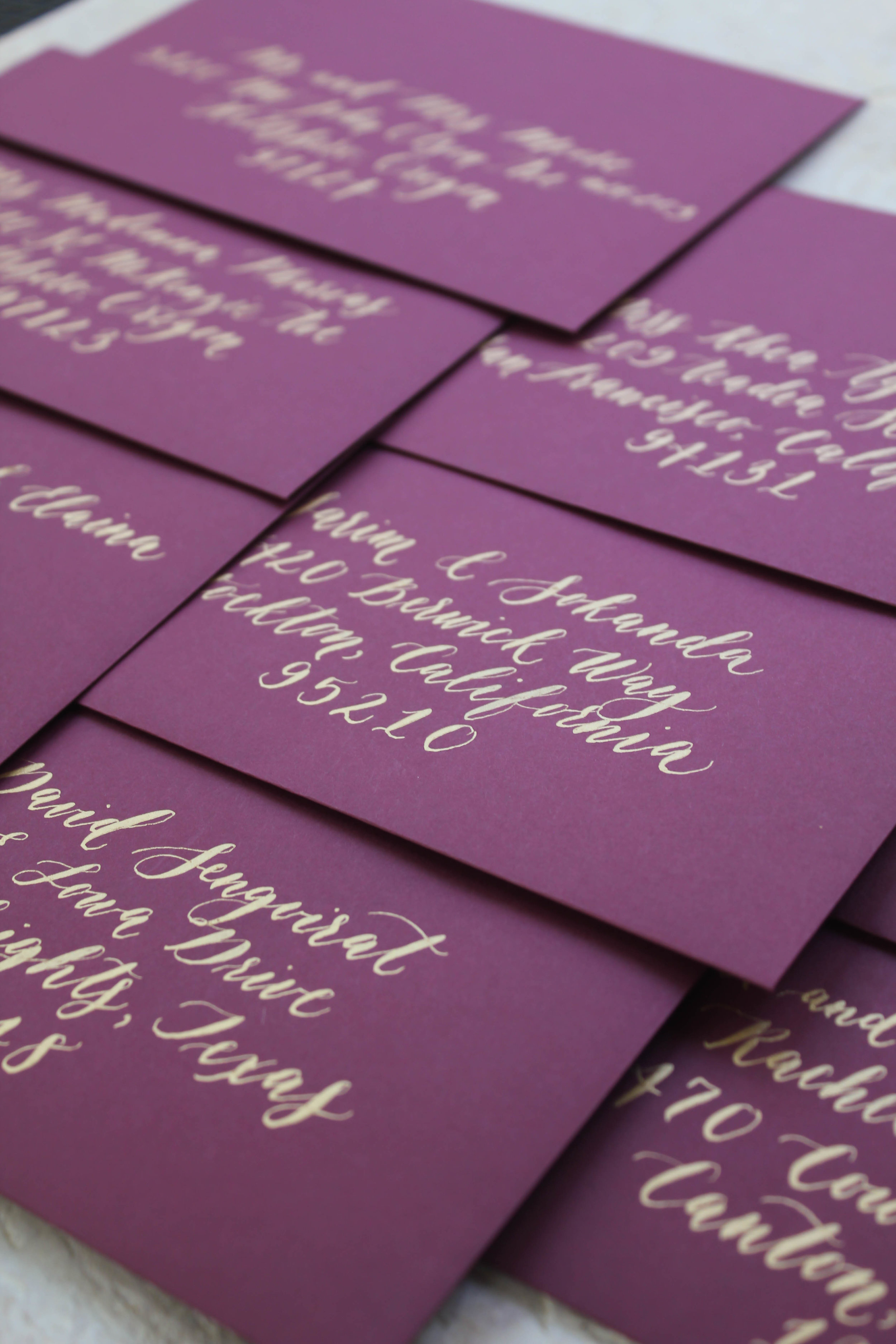 A gorgeous combination of gold ink on burgundy/wine colored envelopes