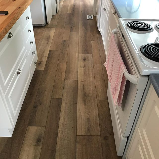 This house had a mix of carpet sheet vinyl and tile. We were able to get everything level with plywood and levelling compound and run this multi width vinyl plank right through main floor. We made the square nose too. #harbingerfloors #whiteoakflooring #multiwidthplanks #vinylplank #squarenose