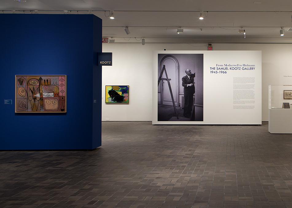 """Installation view of """"From Motherwell to Hoffman: The Samuel Kootz Gallery"""" at the Neuberger Museum.  At left:  Adolph Gottlieb  Pictograph  1946 36 x 48"""" Oil on canvas"""