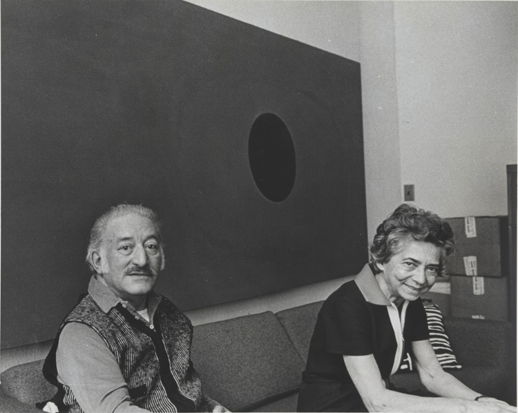 Adolph and Esther Gottlieb in their West Broadway loft, 1971  In the background: UNITS #4, 1966, acrylic on canvas, 95 7/8 x 144 1/2""