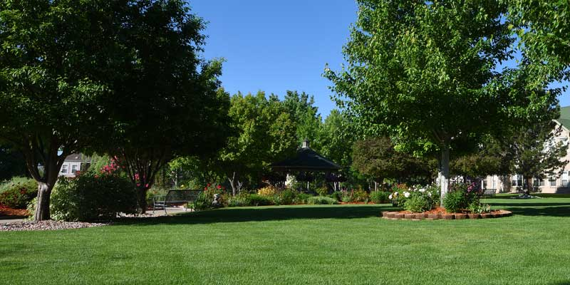 Safe and secure dementia care facilities with outdoor garden space at  T  he Gardens at Columbine