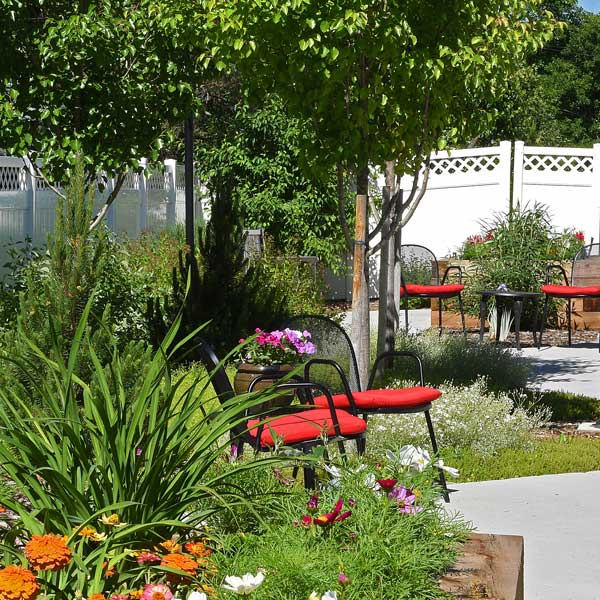 A team of professionals provides a higher level of care amidst the bountiful gardens at The Gardens at Columbine