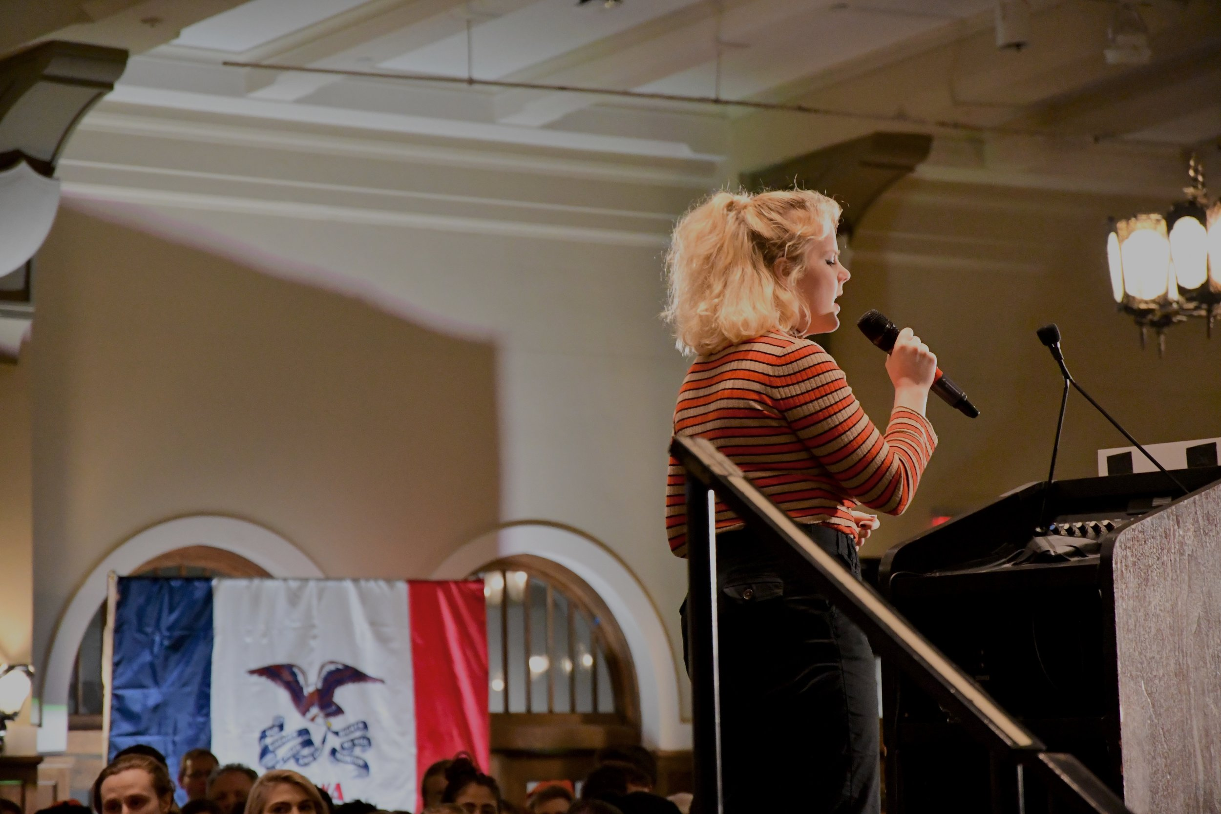 University of Iowa student Elly Hofmaier performing the United States National Anthem at the rally on Friday March 8th, 2019.  Photo by Olivia Harter