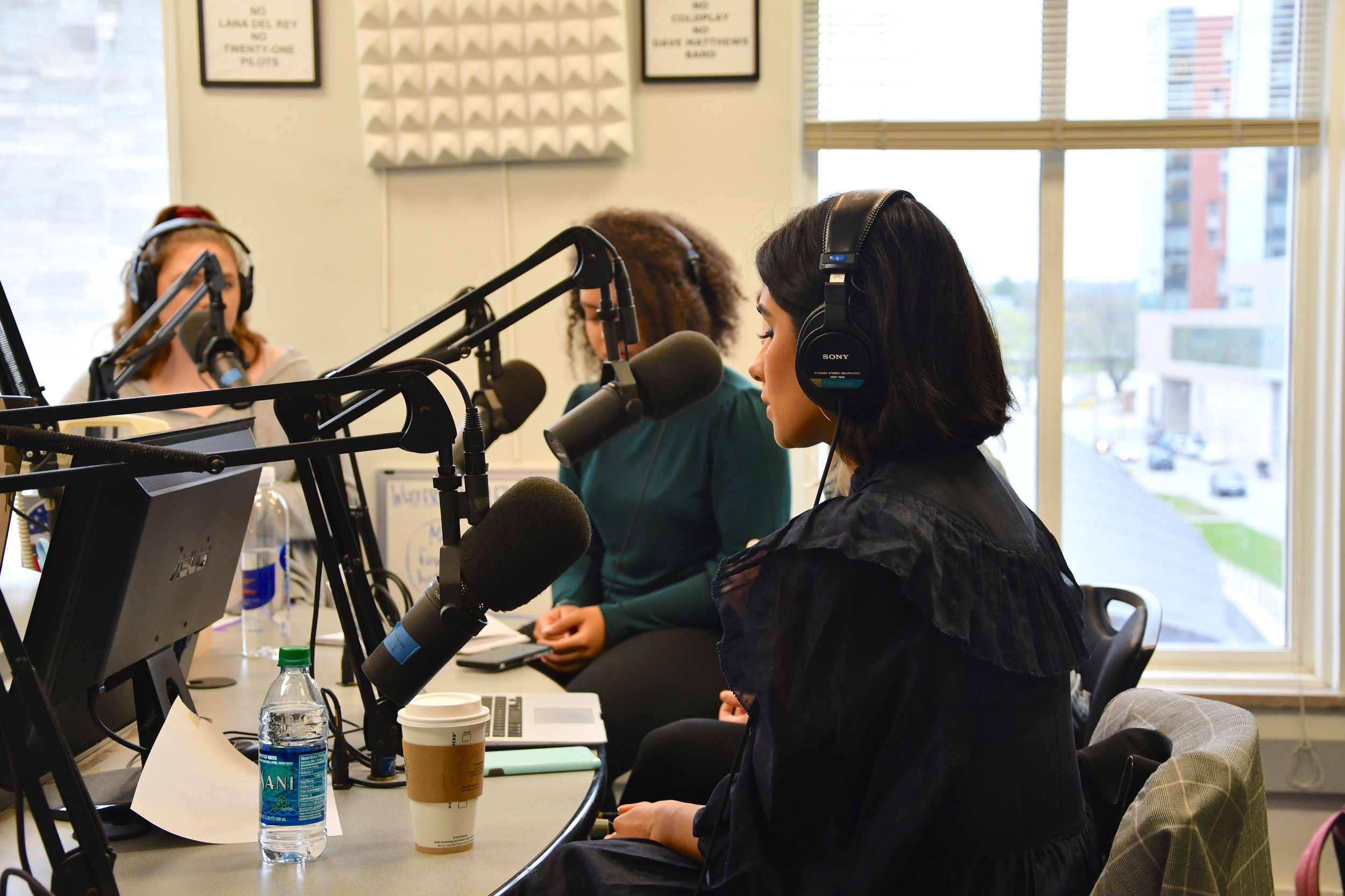 Diane Guerrero in the KRUI studio-recorded interview with  Fools  writer Nichole Shaw and other Iowa City journalists.  Photographed by Olivia Harter.