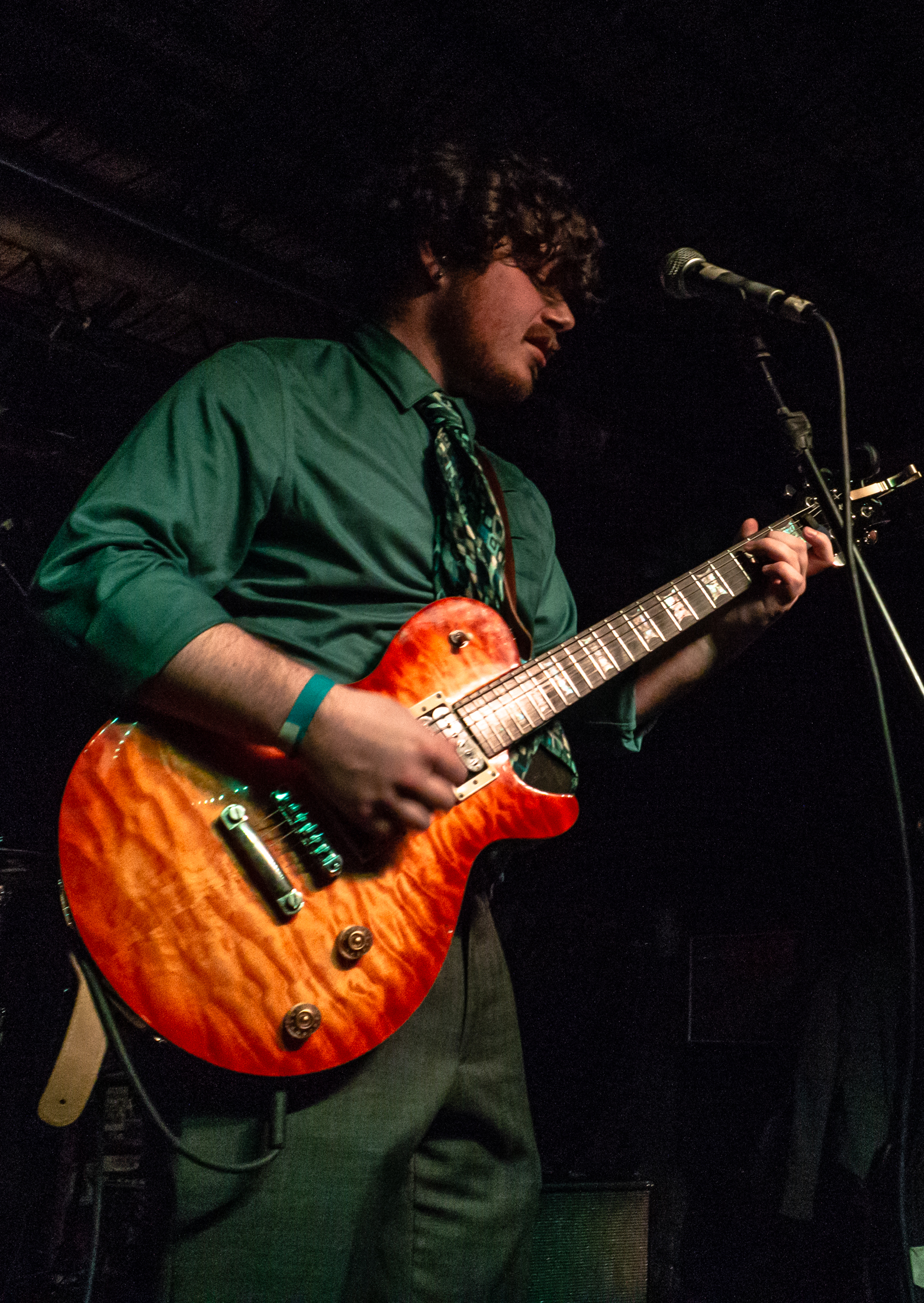 Peter Dressel, vocalist and rhythm guitarist, performing at Gabe's Oasis in Iowa City.  Photo by Melinda Ehrp