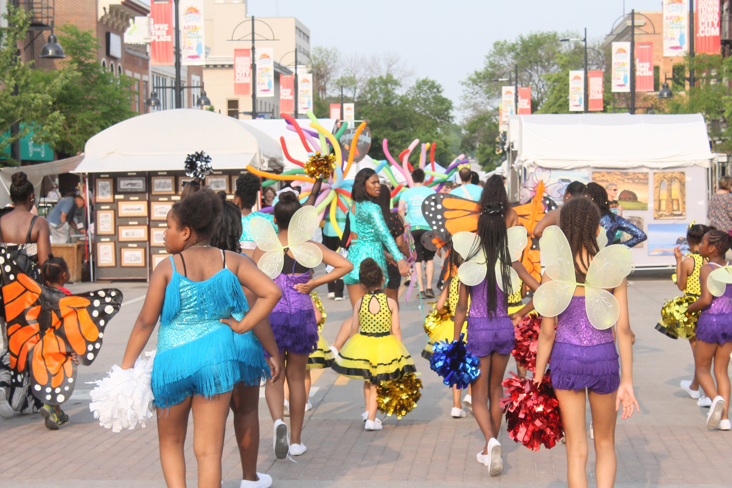 Winged dancers move along the parade route. Photo by Lauren Arzbaecher