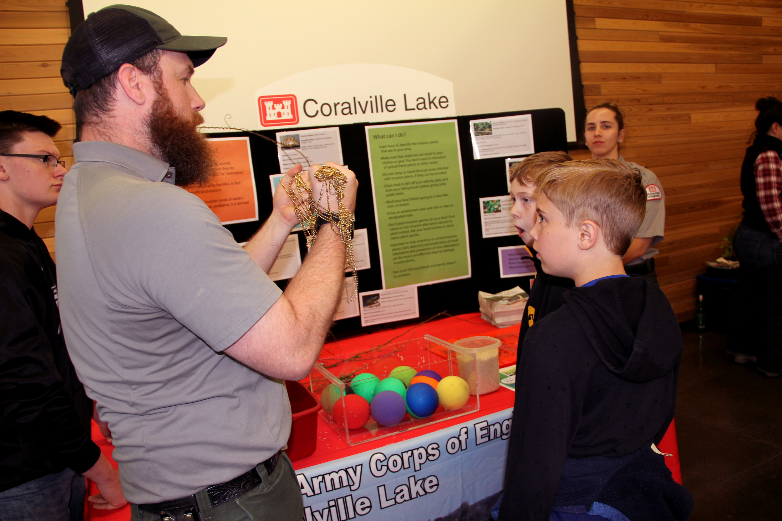A volunteer teaches kids about invasive species