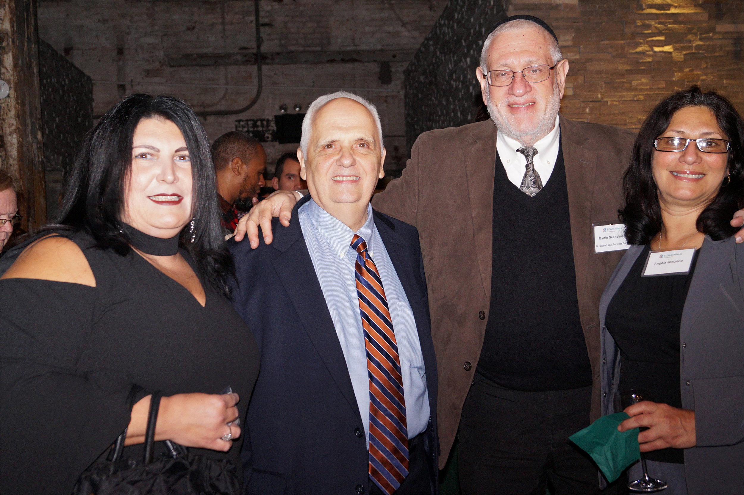 St. Nicks Alliance honored leaders in education and protectors of community at 2017's Benefit. (l to r) RoseAnn LaCioppa (Principal of PS 250), Assemblyman Joe Lentol, Martin Needelman Esq. (Executive Director & Chief Counsel, Brooklyn Legal Services Corp. A), and Angela Aragona (PS 132 teacher)