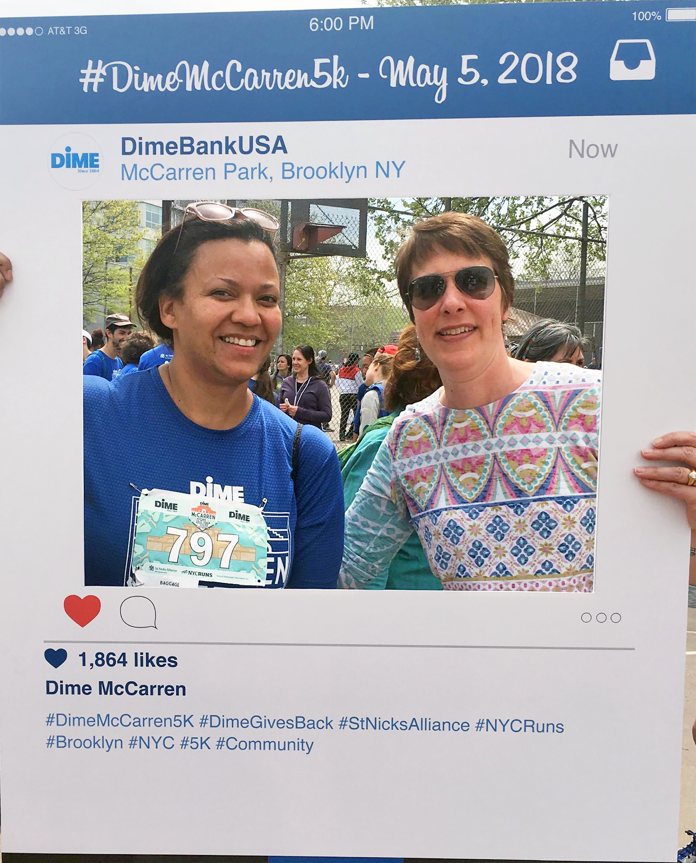 (l to r) Board members Laura James and Lydia Morris came out to support this fundraising run and had some fun posing behind the social media frame!