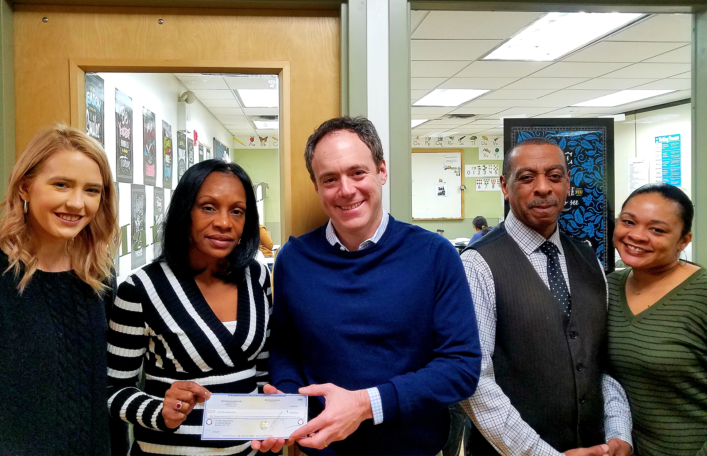 Pictured with David Lombino from left: Ashley Hickerson, Case Manager; Beatrice Brown, First Job Program Manager; Milton Brown, Job Readiness Trainer; and Dominic Savage, Transformational Coach.