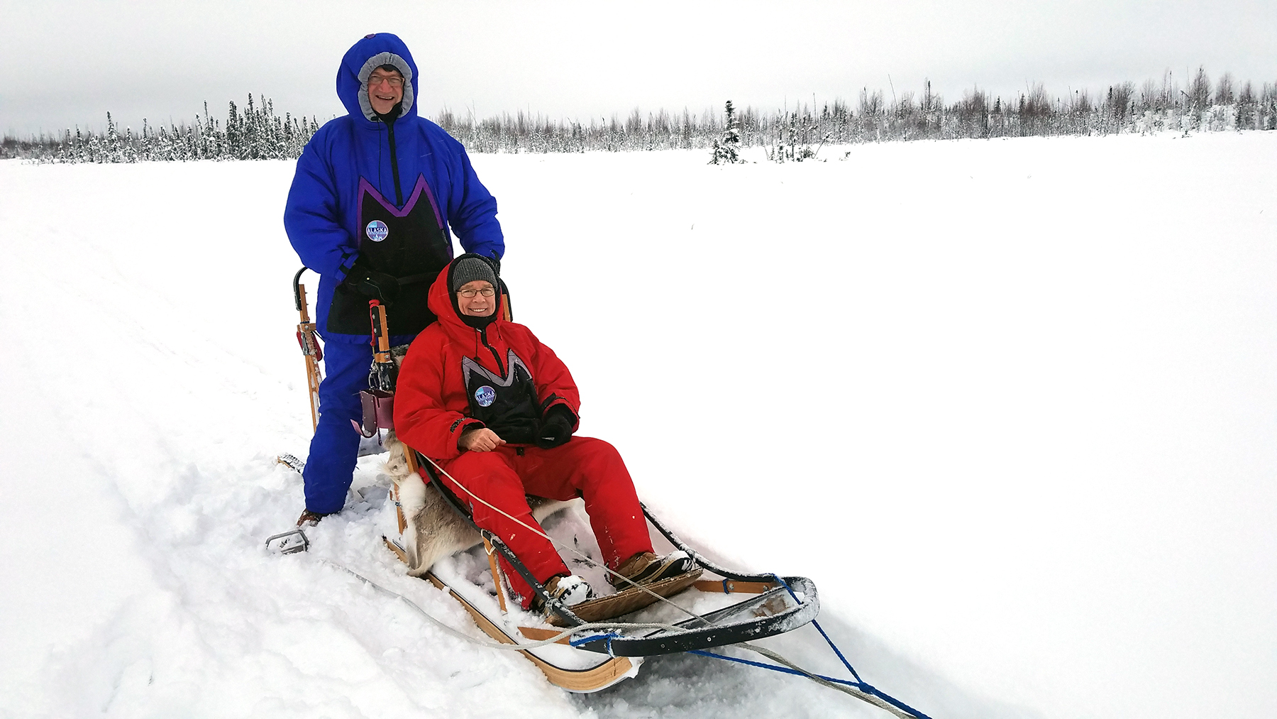 When in the tundra dogsled, Frank with Dana Totman, (Ex. Dir. of Avesta Housing, Maine) take a spin on local transportation.