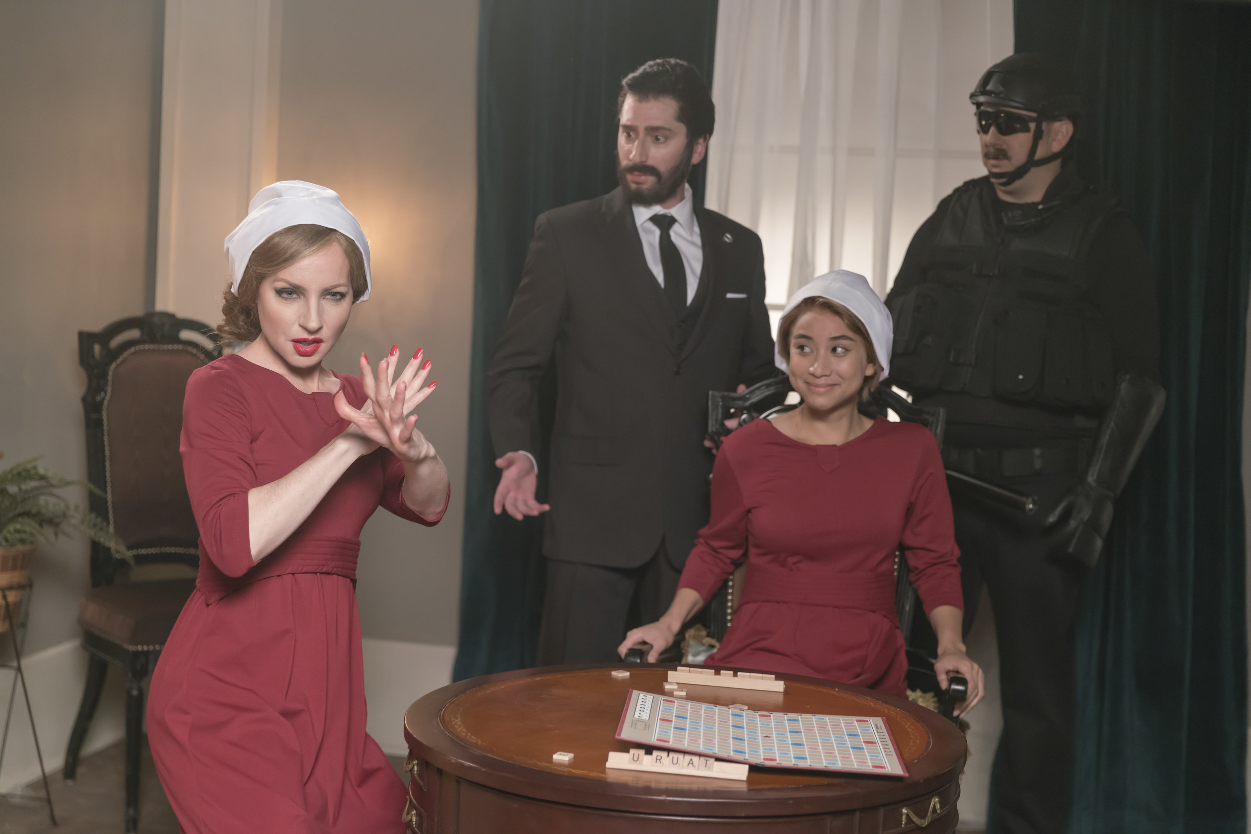 Look what you made her do! Taylor Swift (Jessica Holmes, left) joins the cast of The Handmaid's Tale (with Chris Wilson, Isabel Kanaan, and Craig Lauzon).