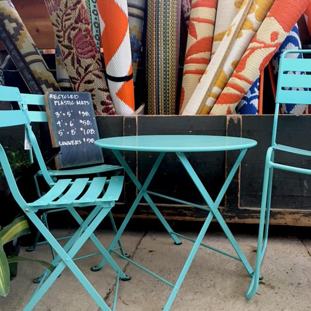 Blue cafe furniture + bright rugs.jpg