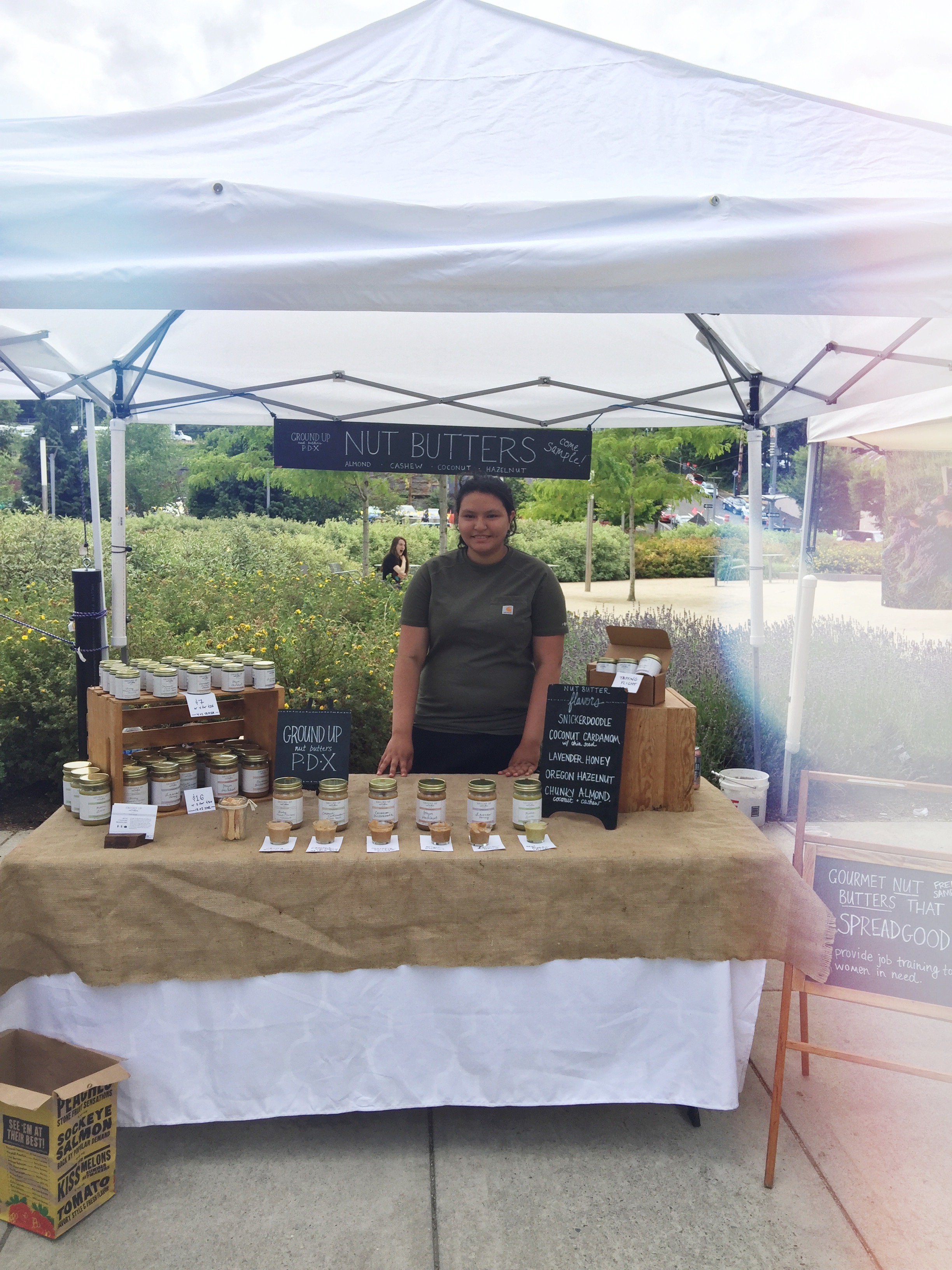 Meet Cynthia! She's working the South Waterfront Farmer's Market in this photo.
