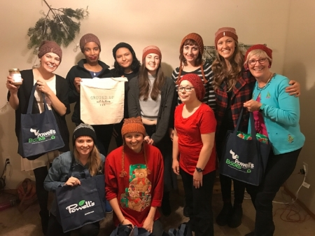 The Ground Up team showing off our new swag at the team holiday party!