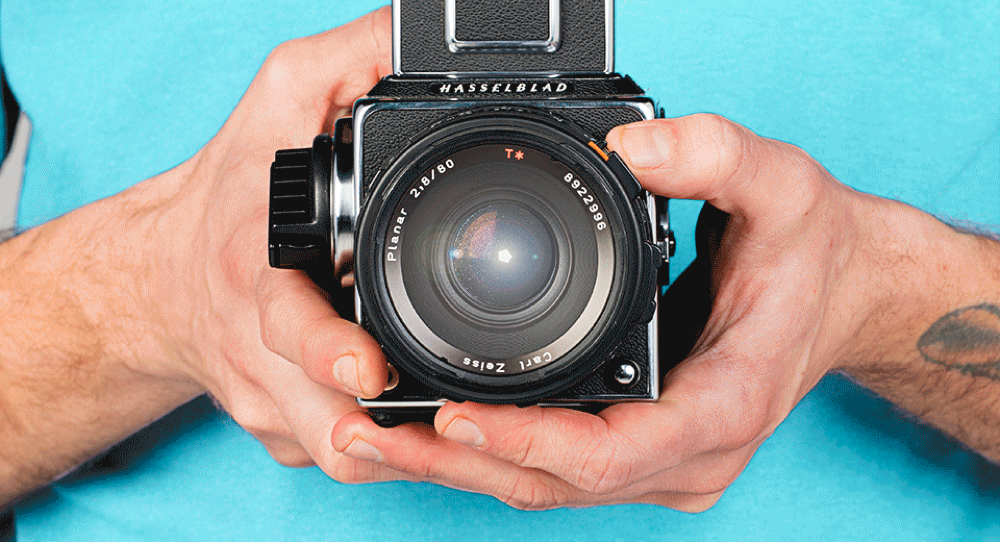 Photo of a person holding a camera illustrates your vision and your choices to promote items on eBay to earn commission.