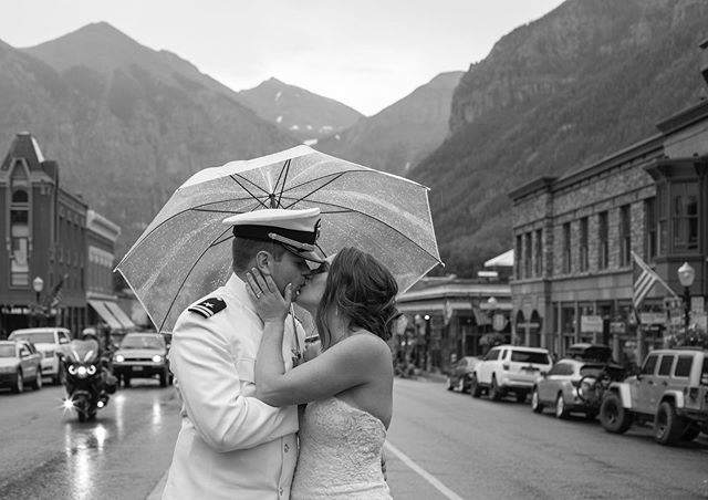 Epic rainy day wedding in Telluride! ☔️⠀ I've been working on the final edit of this wedding I shot a few weeks ago and loving every image! ⠀ 💜 Moody lighting + Navy whites = Showstopper! ⠀