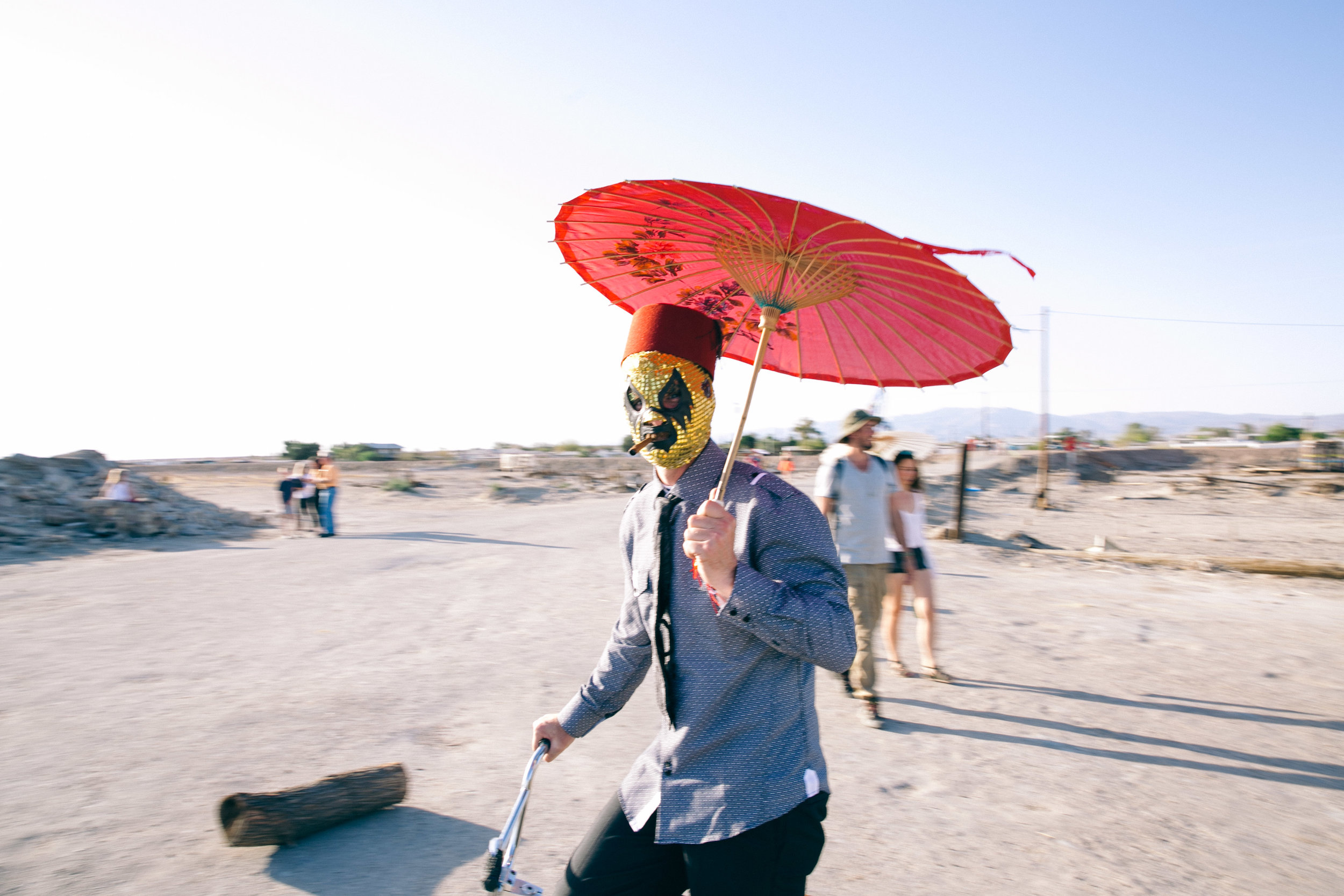 bbb_frank_web_070_Masked attendee at the Beach Club.  Bombay Beach Biennale 2017.jpg