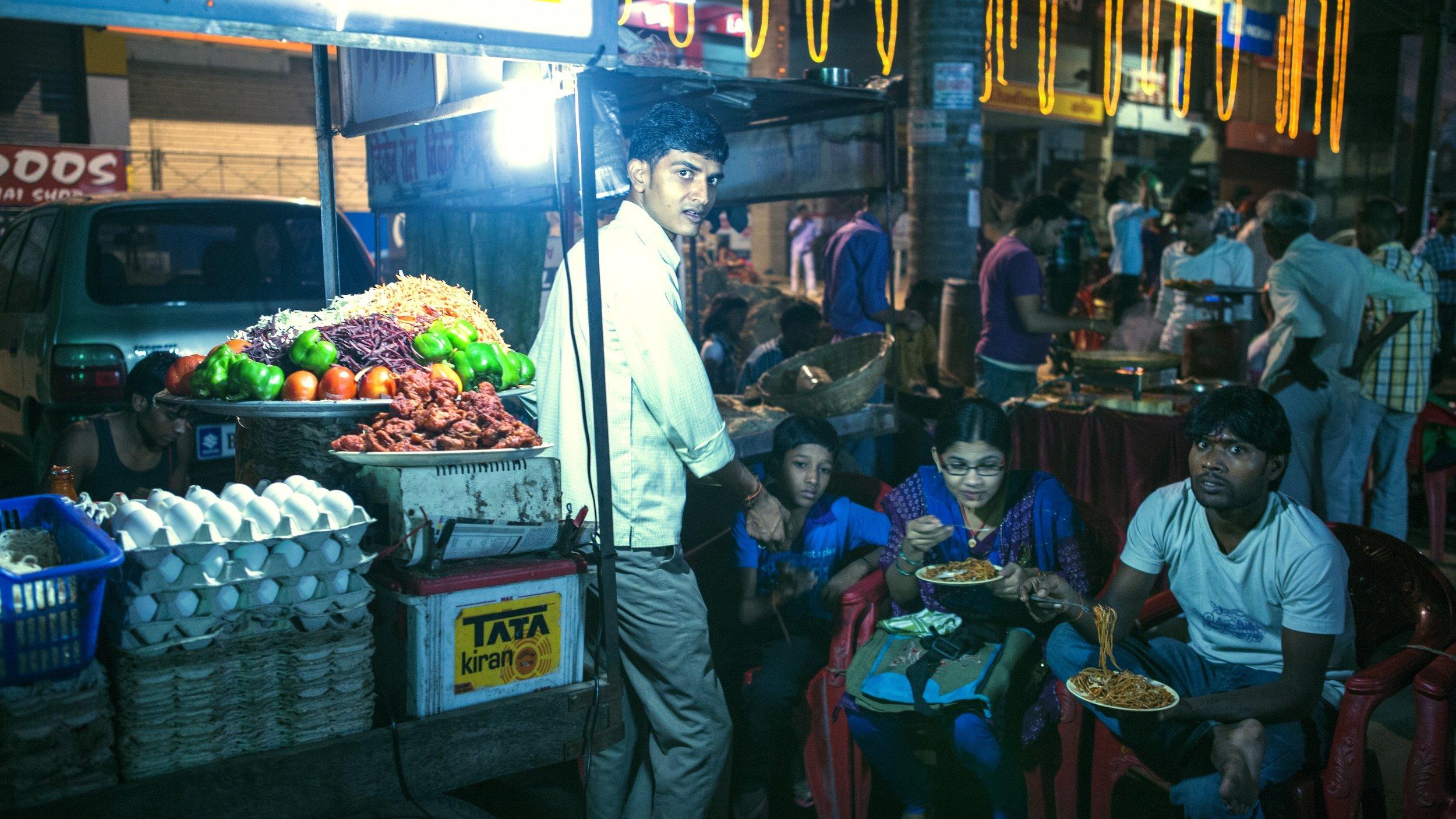 people eating food at festival.jpg