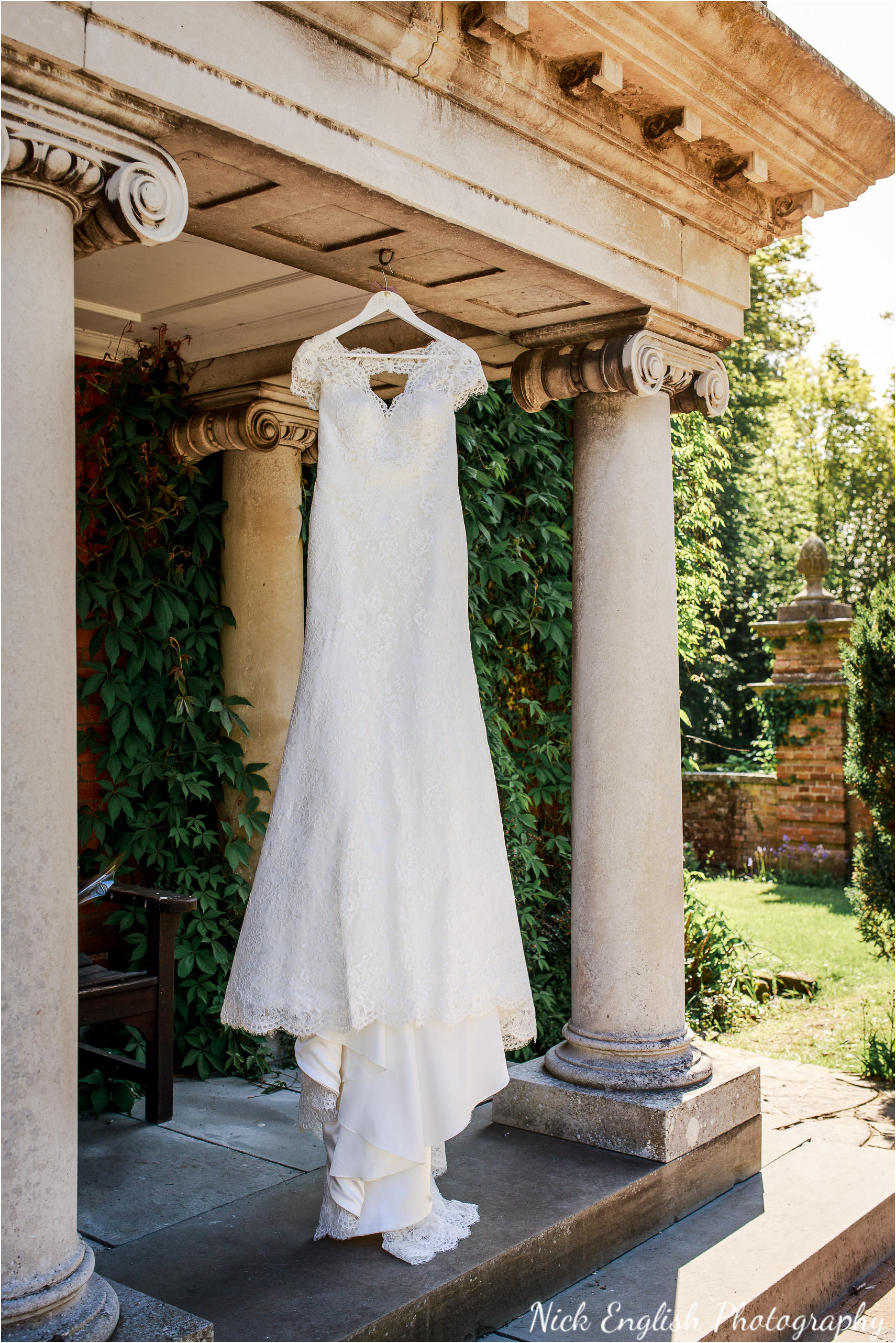 Wedding dress hanging from  The Lodge, Eaves Hall