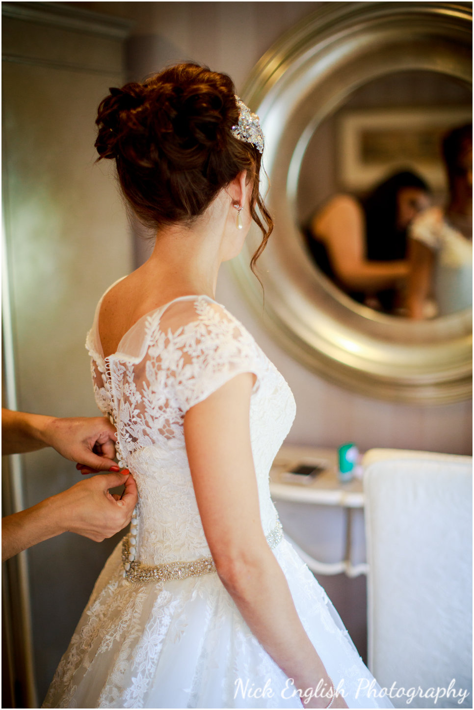 Jamie-Lee, the bride, getting into her wedding dress in The Lodge at Eaves Hall