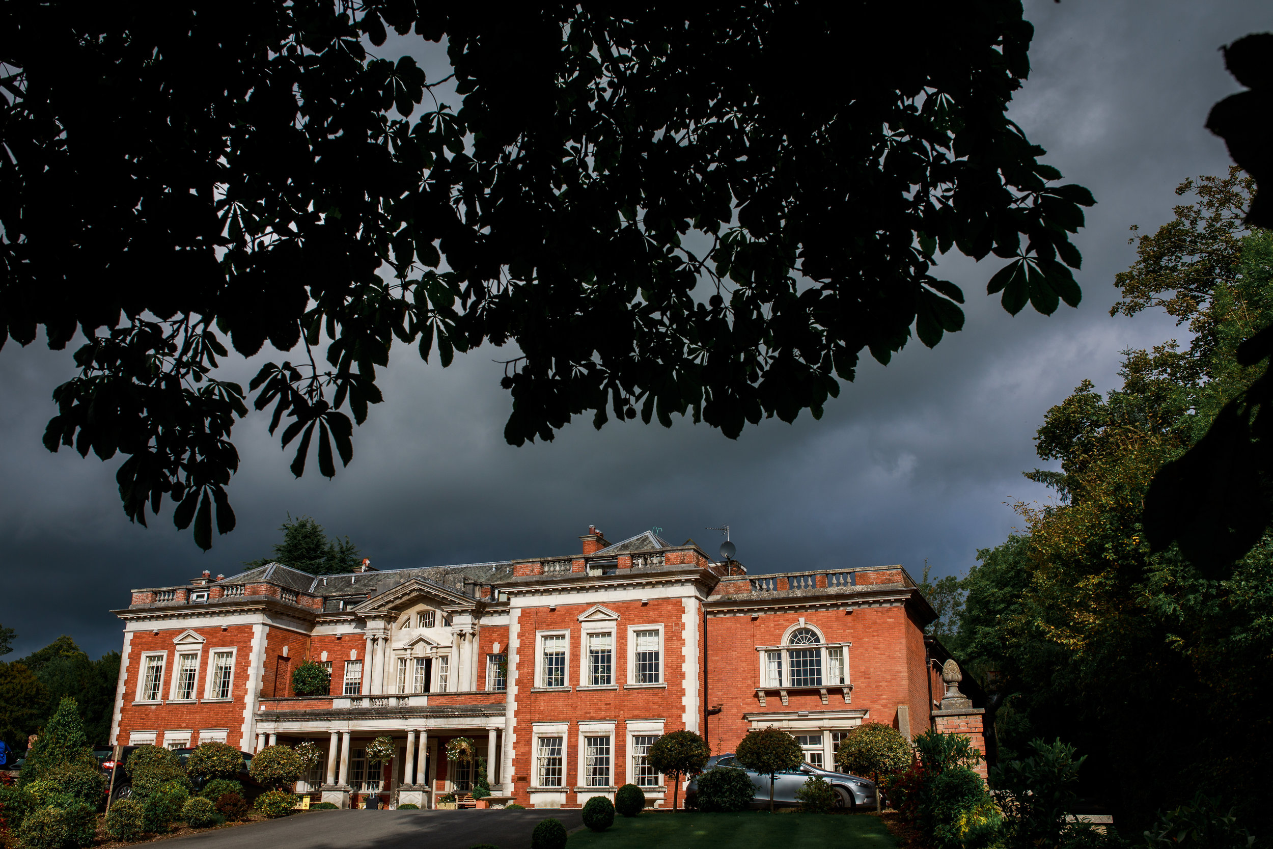 Eaves Hall in sunshine on stormy day