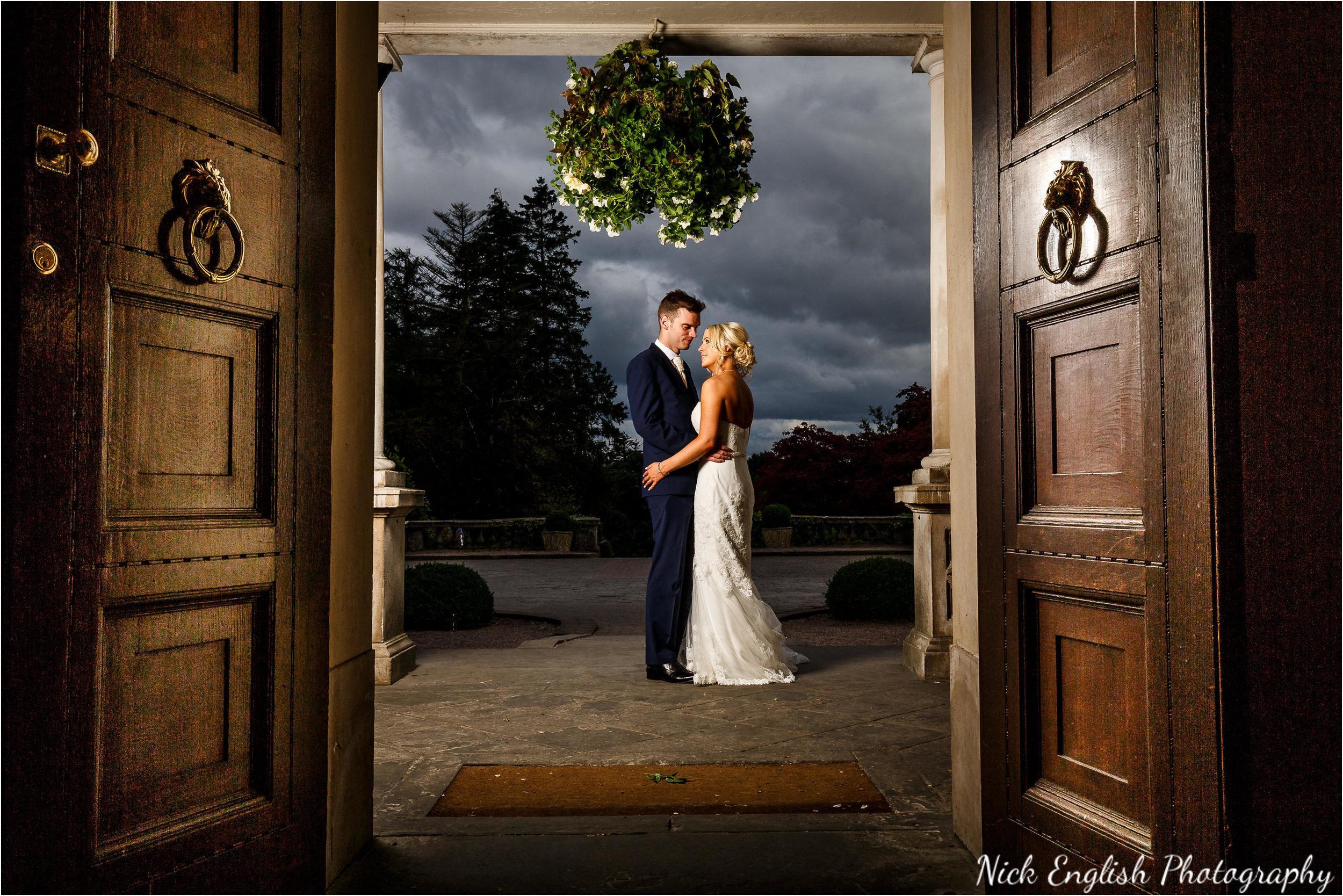 Bride and Groom in Eaves Hall Entrance doorway