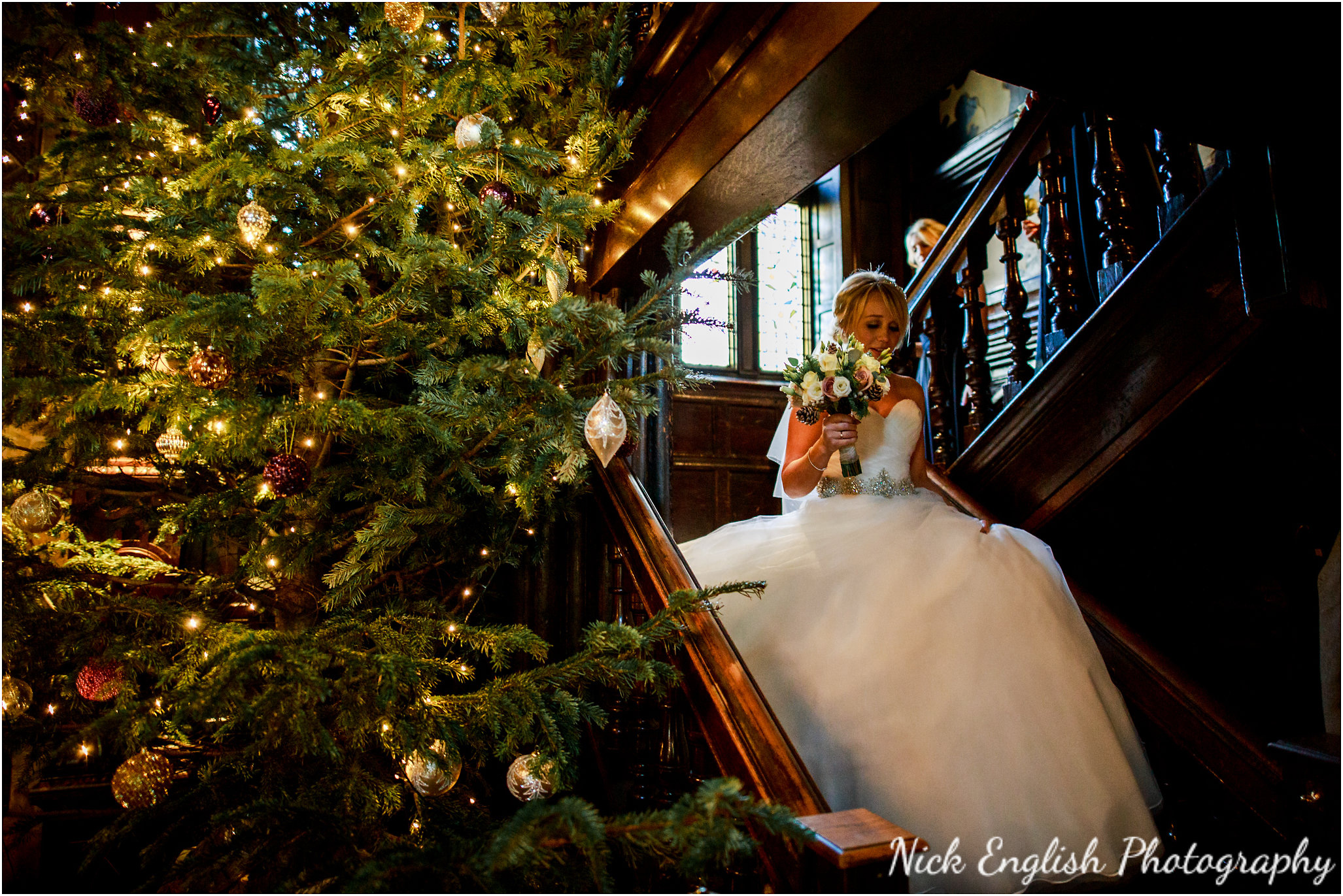 Mitton Hall bride passing christmas tree on the way to get married!