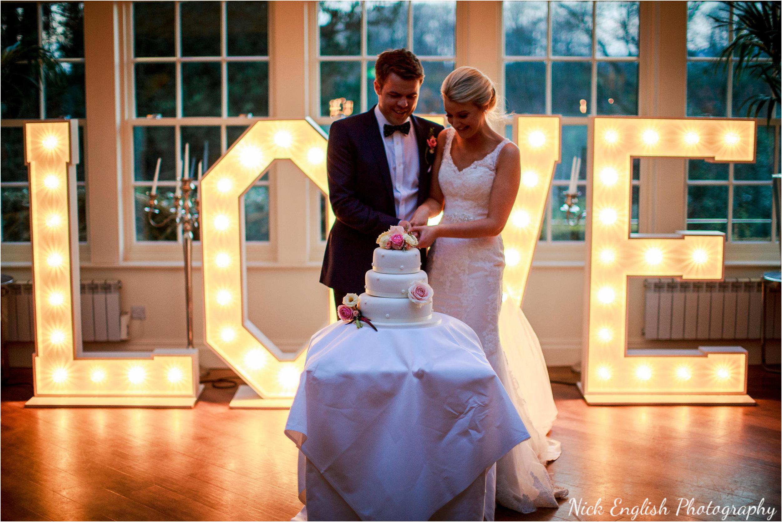 Mitton Hall Bride Groom Cake Cutting