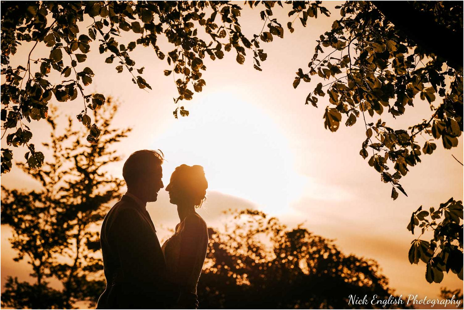 Wedding photographs at browsholme hall at sunset by the lake