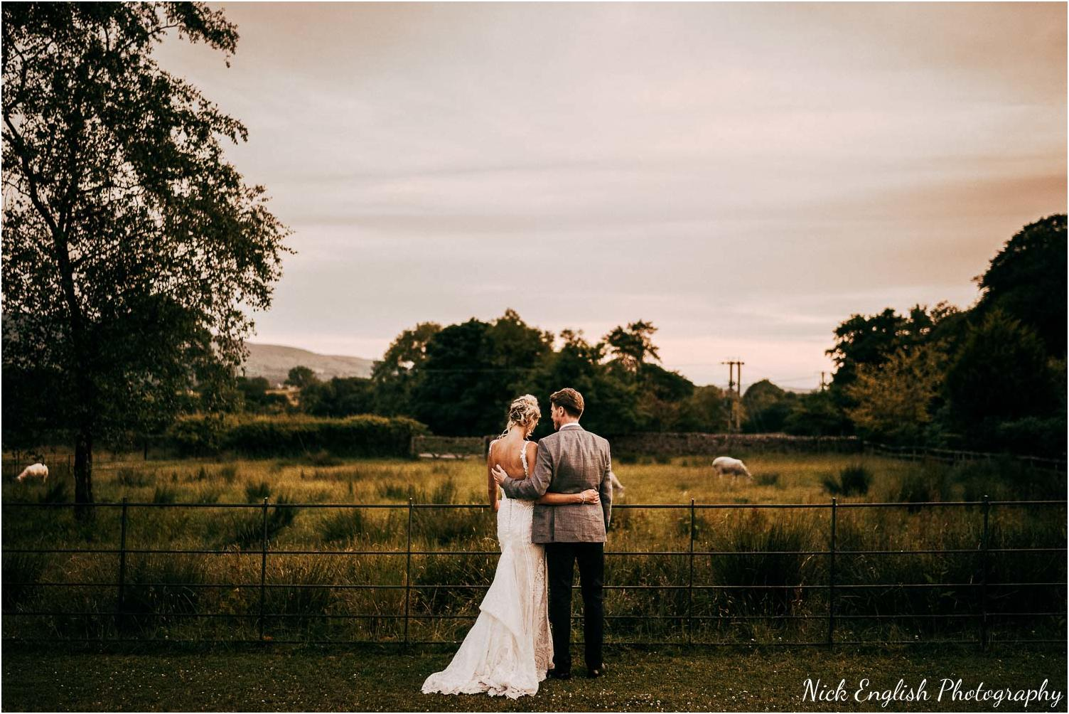 bride and groom enhoying ribble valley views - browsholme hall near the tithe barn