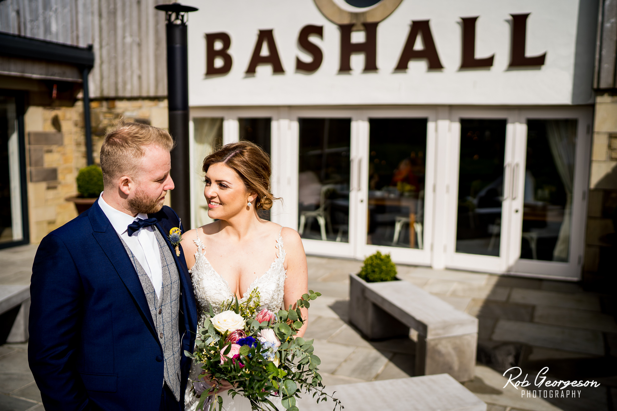 Bride and Groom at the main entrance to Bashall Barn