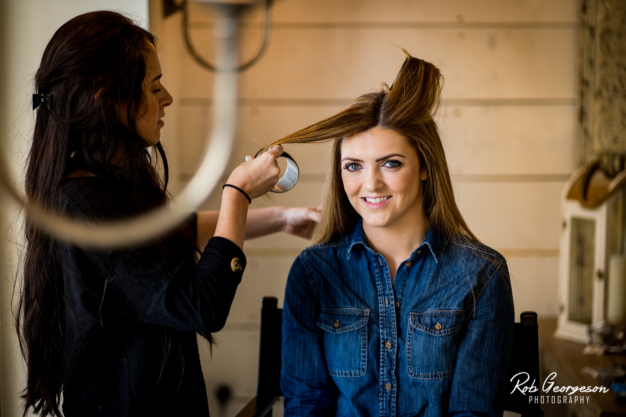curling bridal hair for bashall barn wedding photography