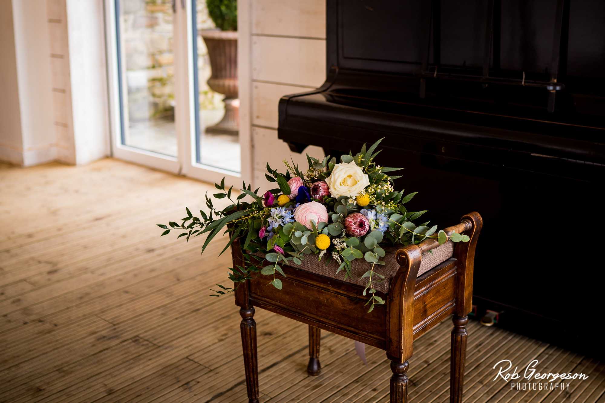 bride bouquet of flowers on a piano stool
