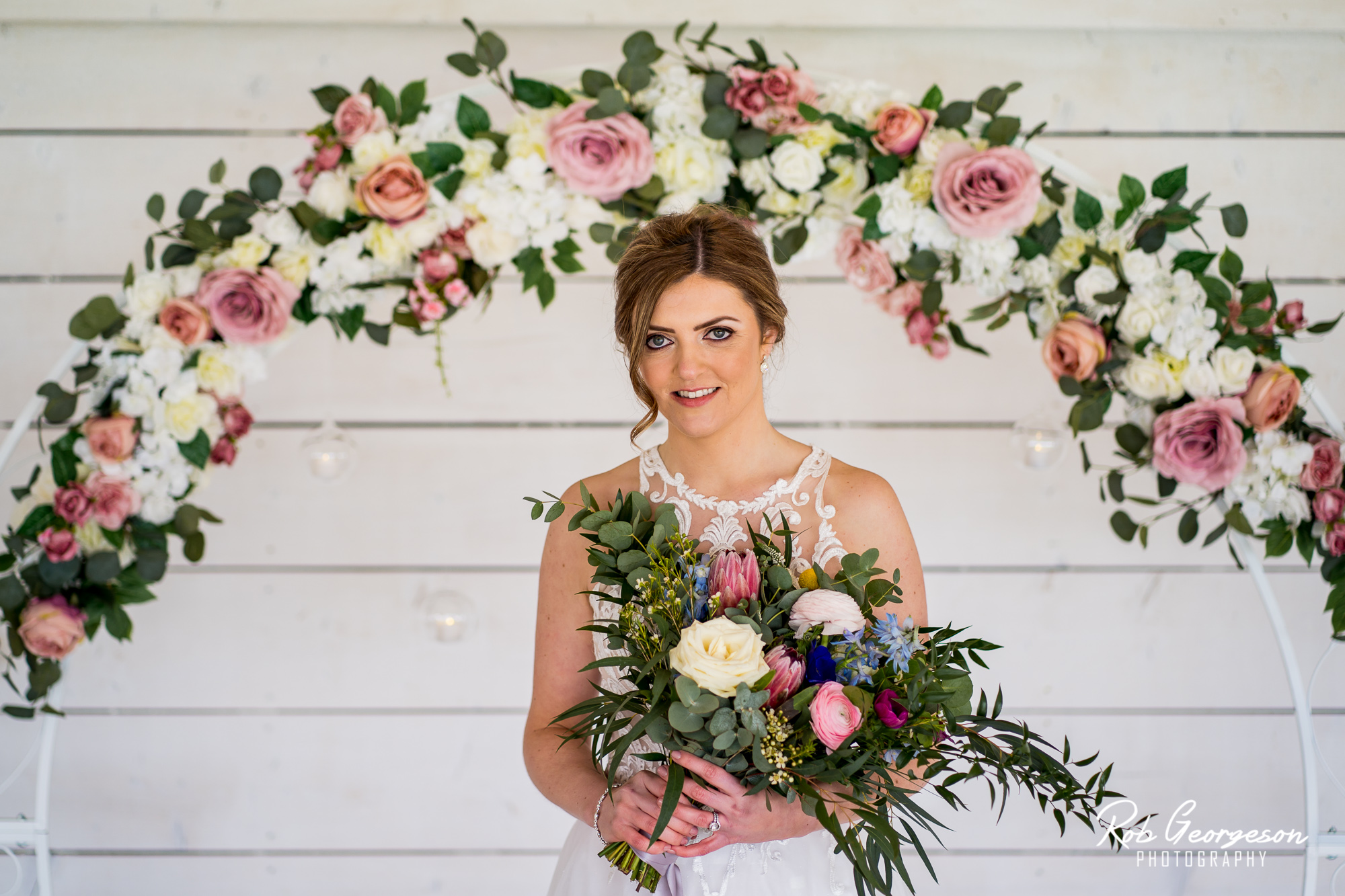 bride with her bouquet and flower ring