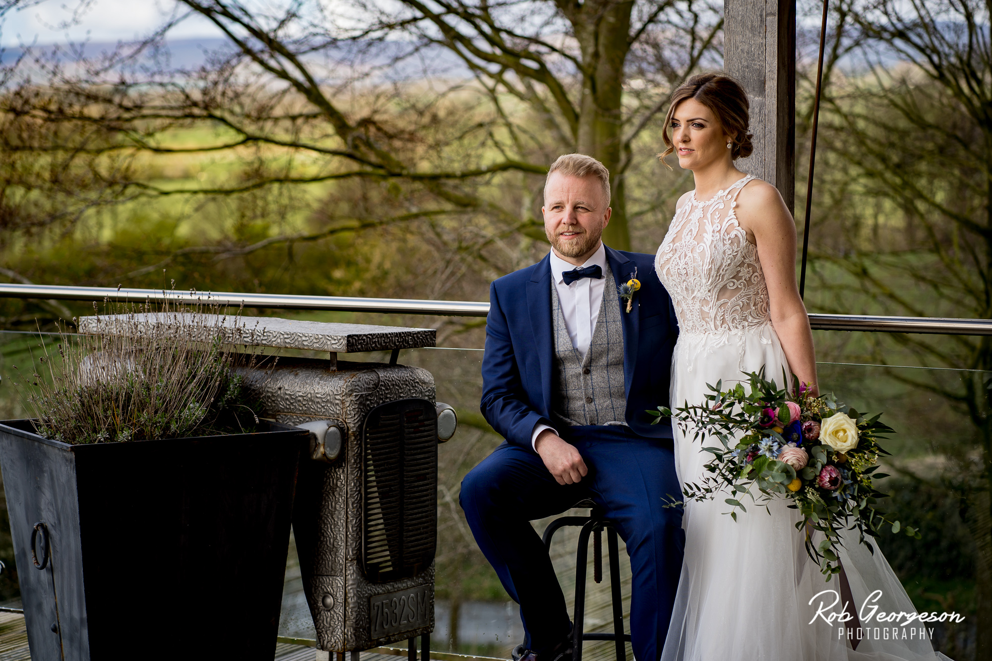bride and groom together on the balcony of bashall barn