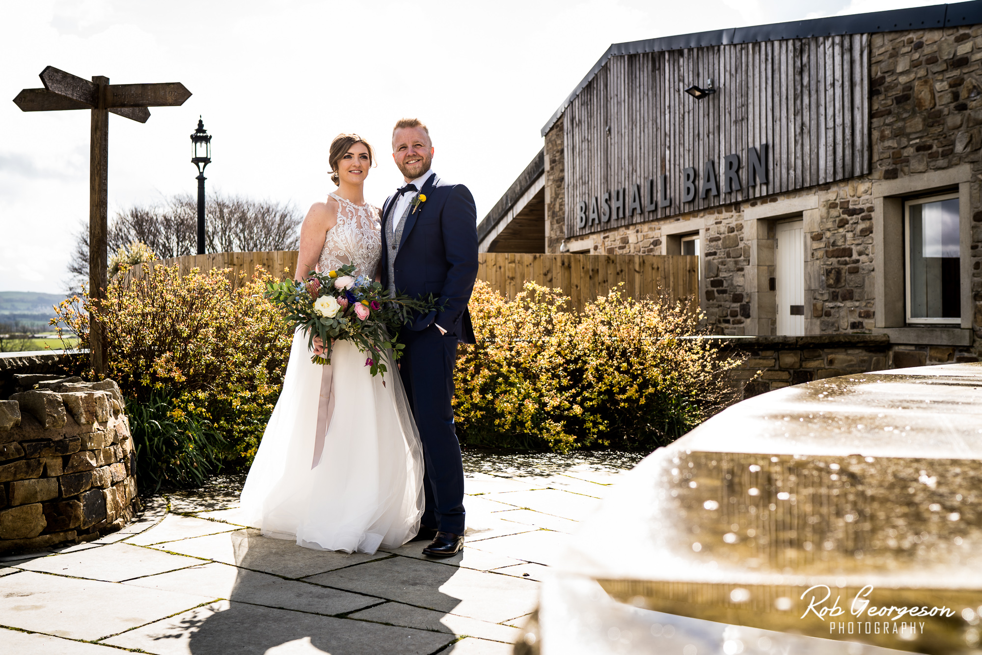 bride and groom at the cow shed at bashall barn