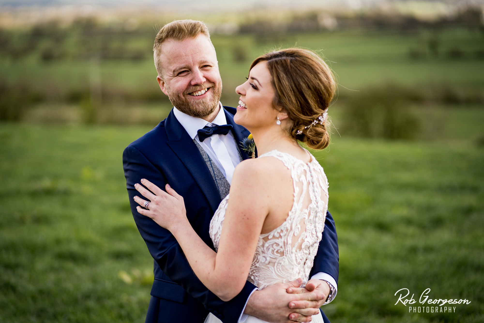 bride and groom portrait in the field at bashall barn