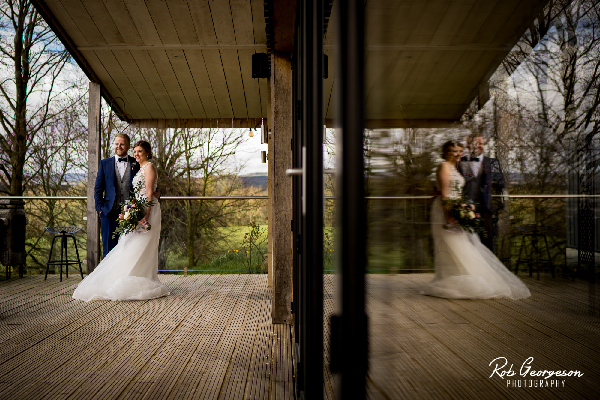 patio door reflection of bride and groom at bashall barn