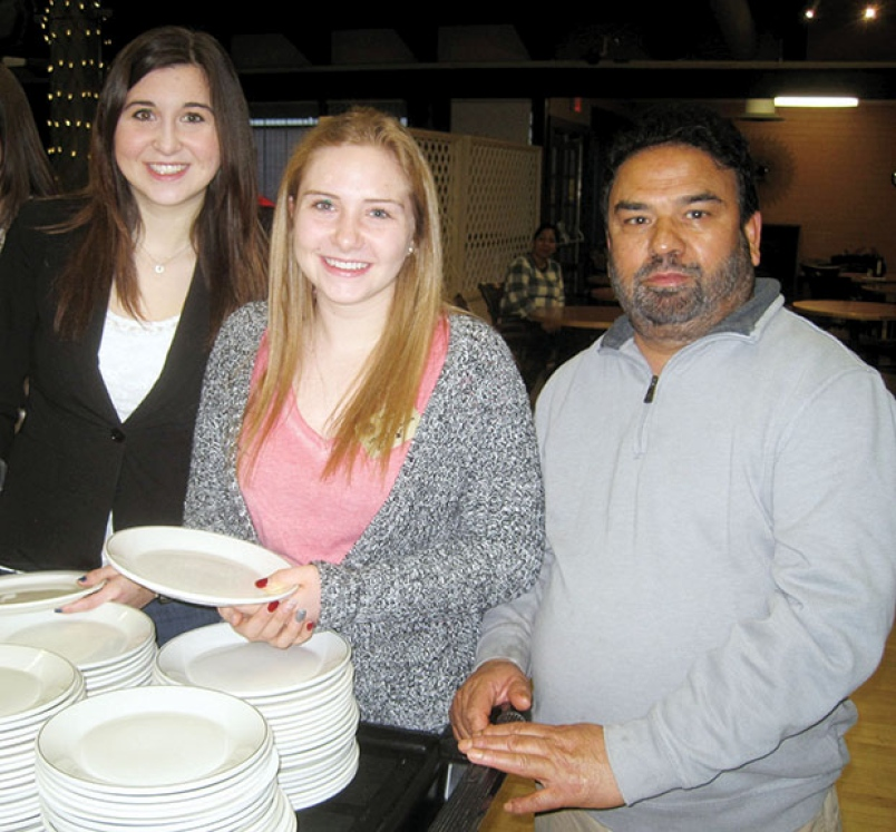 Delaney Griffiths and Erin Turko of the South Delta Secondary Interact Club are shown with Sukhvir Singh Bansal, owner of Connaught Place Restaurant. Photograph By submitted - See more at: http://www.delta-optimist.com/community/rotary-celebrates-indian-milestone-1.876082#sthash.lE9LfoLV.dpuf