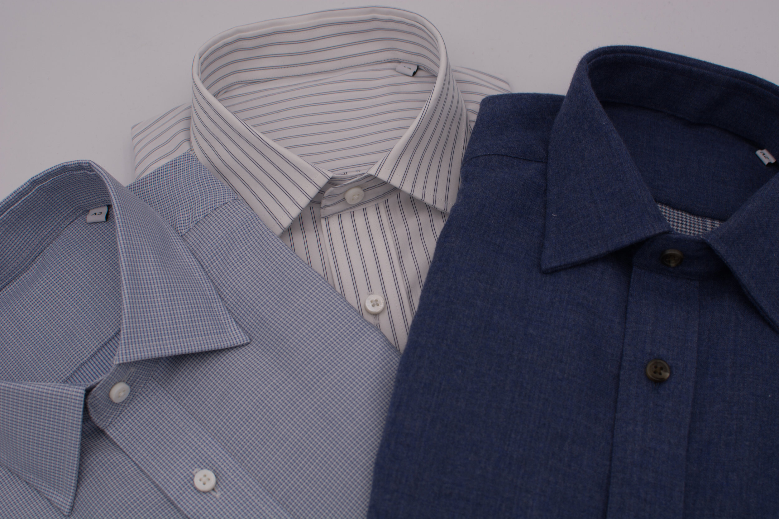1. SLATE BLUE FLANNEL  A hearty brushed cotton in a unique blue-grey slate tone with brown horn buttons and a spread collar. Wear it under a tweed jacket as a dress shirt or on its own layered over a T-shirt as an overshirt. The soft touch feels great and pairs well with denim and khaki trousers.  2. BLUE HATCH WEAVE  A textured take on the blue dress shirt. Woven with overlapping white and blue threads in a dense check hatch weave, this dress shirt adds some variety to your wardrobe of light blue shirts. Pair it with classic suits in greys and blues, but also consider it as a compliment underneath sweaters. Features a semi-spread collar and thick mother of pearl buttons.  3. DOUBLE NAVY STRIPE  A white shirt that doubles up on a widely spaced pinstripe. In a broadcloth weight that's perfect for business to business casual dress. Works great with ancient madder and geometric neckties and even with wide-striped ties or knit ties. With a raised placket and semi-spread collar, it's a classic work shirt.